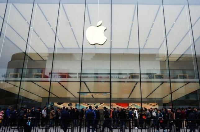People line up outside an Apple store as iPhone SE goes on sale in China, in Hangzhou